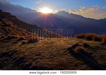 Sunrise in the Himalaya mountains. Machapuchare peak, Fish tail top. Sunbeams. Nepal, Annapurna region, Mardi Himal track.