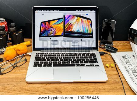 PARIS FRANCE - JUNE 6 2017: Apple Computers website on MacBook Retina in creative environment showcasing latest news from Apple at WWDC 2017 - new faster iMac computer launch