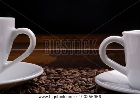 Two Cups With Handles On A Tray Full Of Coffee Beans