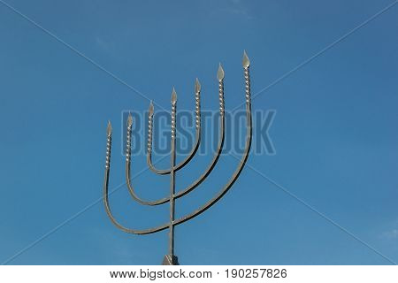 The menorah is a symbol of Judaism the national-religious sign of Israel. Monument to the victims of the Holocaust in the village of Bogdanovka. Ukraine.