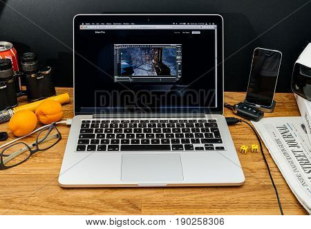 PARIS FRANCE - JUNE 6 2017: Apple Computers website on MacBook Retina in creative environment showcasing latest iMac Pro from Apple at WWDC 2017 - Vr heqdset for games and entertainment
