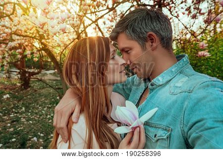 lifestyle couple walking in the woods