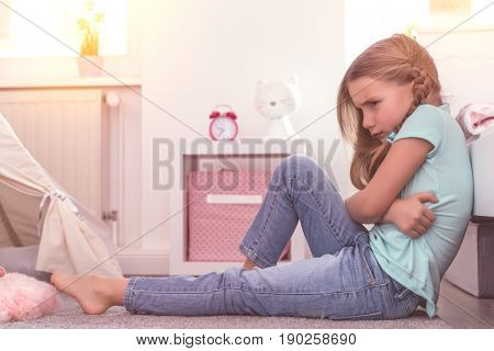 young angry girl after discussion with parents