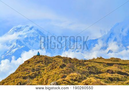 Young woman admires by view in Himalayan mountains. Beautiful Mountain Landscape in Annapurna region, Nepal