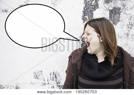 Girl screaming in urban street anger detail