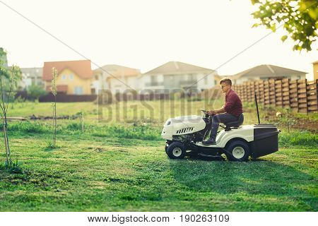Worker Cutting Grass With Lawn Mower, Lawncare Concept. Industrial Details