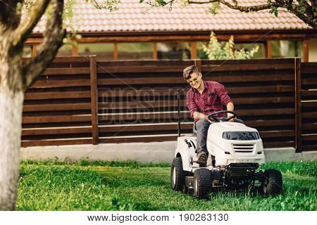Smiling Worker Gardening And Doing Landscaping Works, Using Professional Tools And Machinery