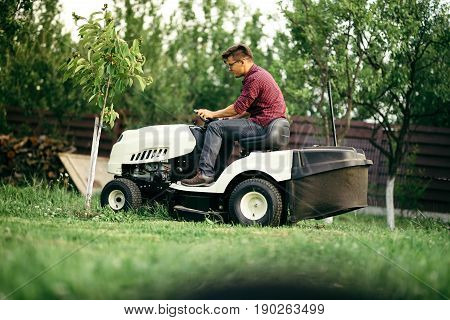 Worker Using Professional Grass Trimmer, Lawn Mower