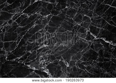 Black and dark marble texture shot through with white deep veining (Pattern for backdrop or background, Can also be used create surface effect to architectural slab, ceramic floor and wall tiles)