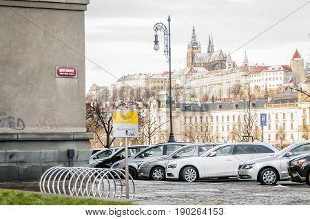 PRAGUE, CZECH REPUBLIC. January 27, 2015. The Prague castle seen through the parking lot on the top of the hill. It is the official residence of the president of the Czech republic.