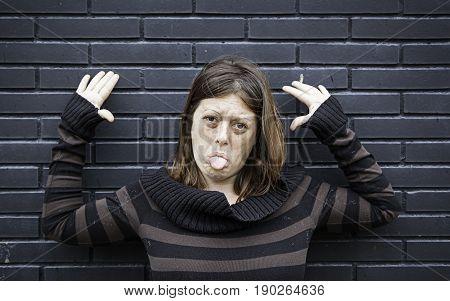 Girl making mockery in urban street detail