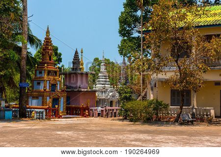 Elaborate and colorful architecture around the grounds of a traditional Cambodian temple