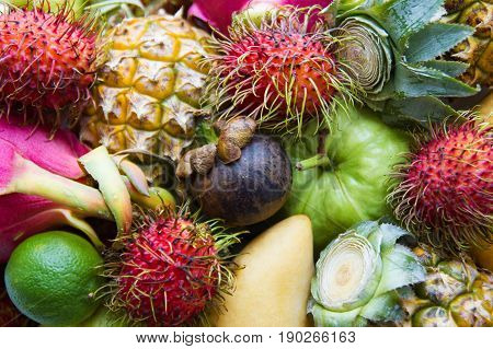 Fresh And Ripe Colorful Fruits Closeup. Dragon Fruit, Pineapple, Lime, Mango, Rambutan, Mangosteen,