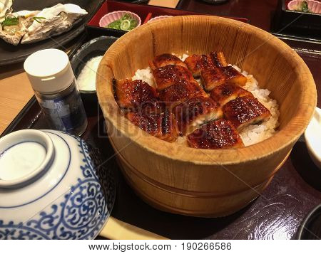 unagi don with white rice topped with grilled eel, bento set, traditional japanese food