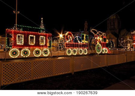 Taunton Massachusetts USA - December 28 2007: Train made of lights among Christmas decorations on the Taunton Green in Taunton Massachusetts