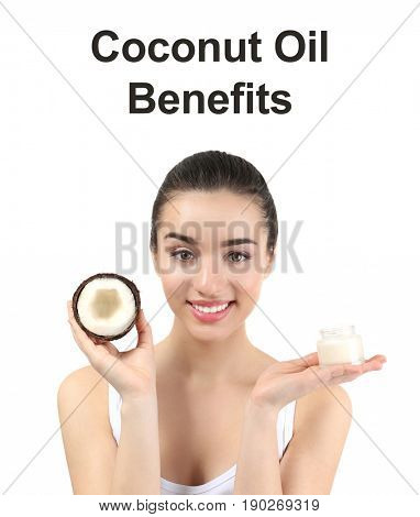Text COCONUT OIL BENEFITS, young woman holding nut and jar of cream on white background. Beauty concept