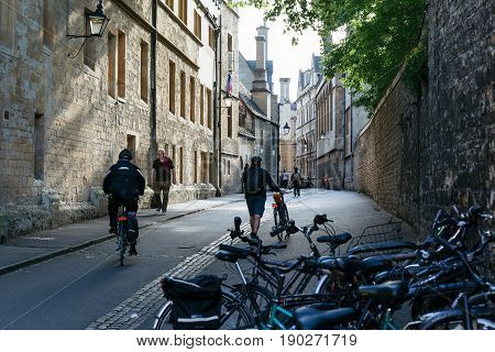 OXFORD, UK - MAY 22, 2017: Cyclists and pedestrians on the street in Oxford, home of famous University of Oxford.