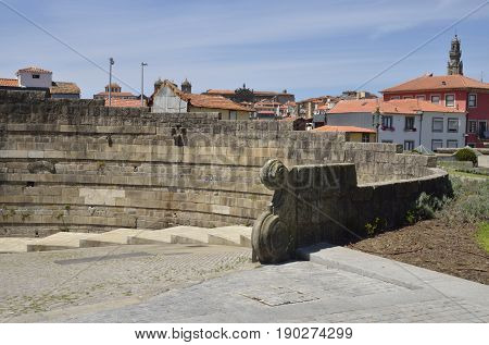 The Clerigos Tower and buildings seen from a square close to the Cathedral of Porto Portugal.