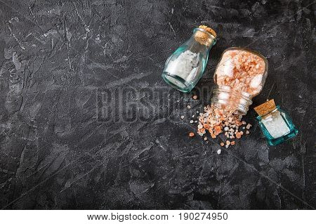 Small glass bottles with aromatic salt. Set for aromatherapy. Top view.