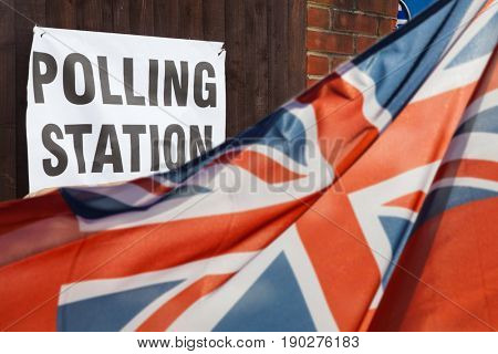 polling station sign and Union Jack flag - UK general elections