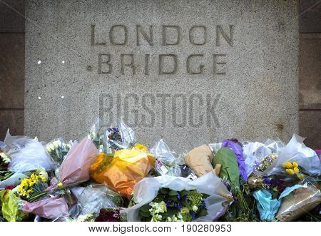 LONDON, UK - JUNE 7, 2017:  Floral tributes laid at the site of the London terrorist attack at London Bridge on the 3rd of june 2017.