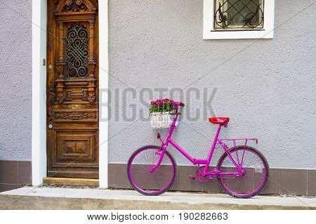 Pink Bike Standing By The Wall
