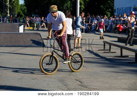 Extreme Bmx Rider In Helmet In Skatepark On Competition