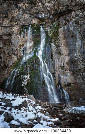 Waterfall flowing over rocks. Geg waterfall. Abkhazia