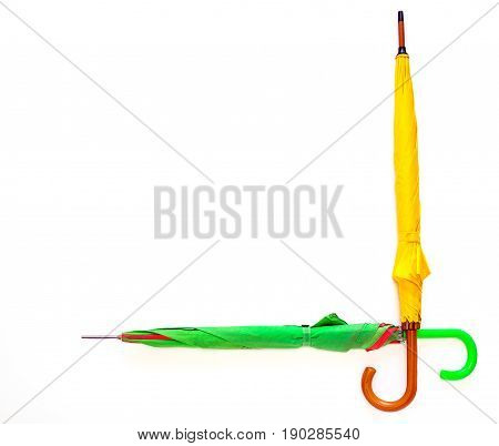 Creative image of umbrellas of different colors on a white background with copy space