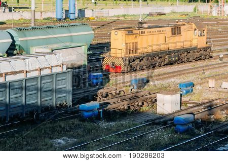 Freight Locomotive Couples The Wagons, At The Railway Station.