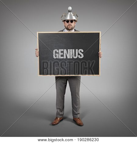 genius text on blackboard with science businessman holding blackboard sign