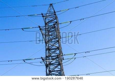 Power transmission line on high voltage post.