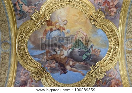 ROME - SEPTEMBER 02: The fresco of virtues of Hope and Truth on the cupola of side nave in Basilica dei Santi Ambrogio e Carlo al Corso by Pio Paolini from (1678 - 81), Rome on September 02, 2016.