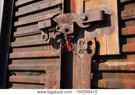 Metal door lock with a seal by freight railway car