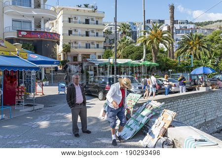 SARANDA, ALBANIA - MAY 18: The artist sells souvenirs on the street on May 18, 2017 in Saranda, Albania. Saranda is the most important tourist attraction of the Albanian Riviera.