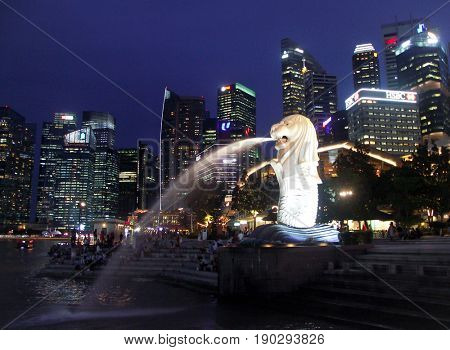 SINGAPORE, 1 June 2017 -The Merlion fountain and Singapore skyline.  The Merlion is an imaginary creature with a head of a lion and the body of a fish and is often seen as a symbol of Singapore.