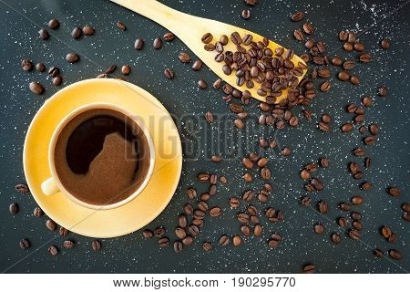 Coffee In Yellow Cup On Black Background.