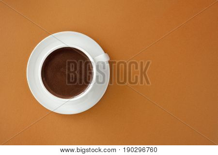 Coffee In White Cup On Brown Background.