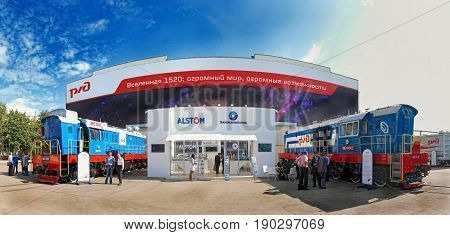 MOSCOW, SEP 10, 2009: Panoramic view on TMH Alstom exhibition stand and shunting locomotives, standing people. Biggest railway industry exhibition in Russia. Event organizer: Business Dialogue