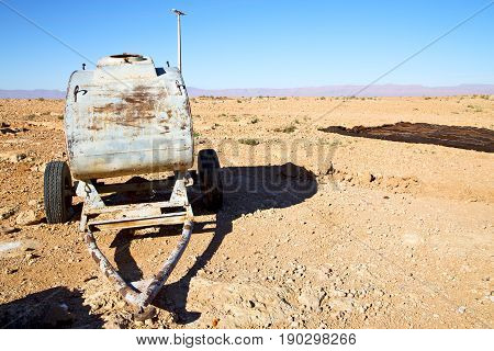 Water Tank In Morocco   Utility Pole  And Arid