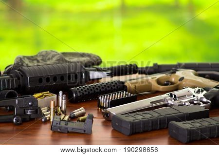 Bullets and a firearm. Bullets are a projectile expelled from the barrel of a firearm, on wooden table.