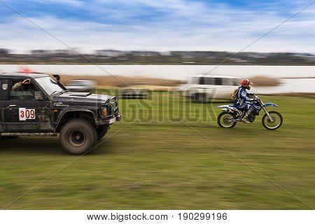 Lviv Ukraine - April 18 2015:Rider ahead of the crew SUV during overcome route around Lviv.Ukraine