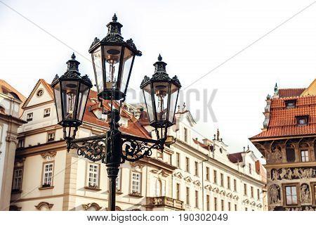 Traditional street lamp on a street in the Old Town Staromestska Namesti of Prague, Czech Republic.