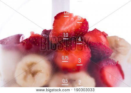Electric Blender with different fruits for smoothie isolated