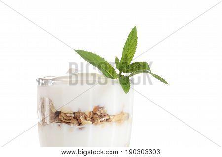 closeup isolated vanilla parfait with granola on white