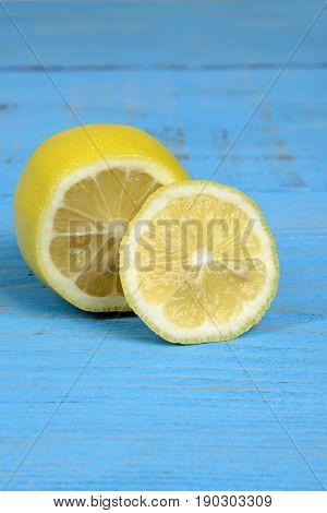 closeup of sliced lemon on blue wood table