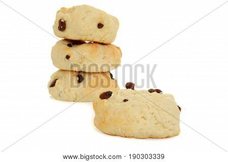 macro scone with raisins on a white background