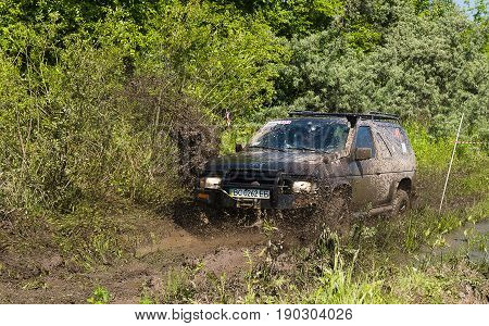 Lviv Ukraine - May 30 2015: Off-road vehicle Nissan overcomes the track on of landfill near the city Lviv.