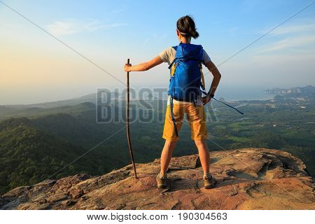 successful woman hiker enjoy the view hiking on mountain peak