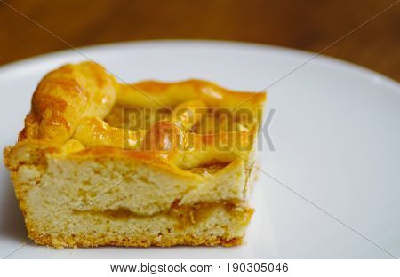 Delicious homemade pineapple cake over a white plate.